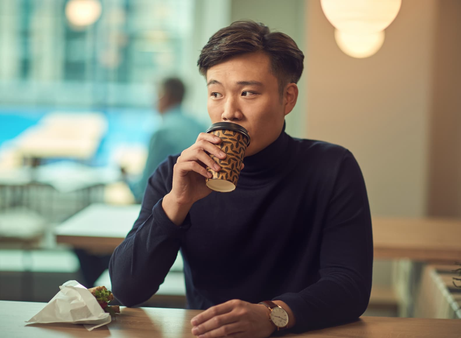 Person drinking coffee