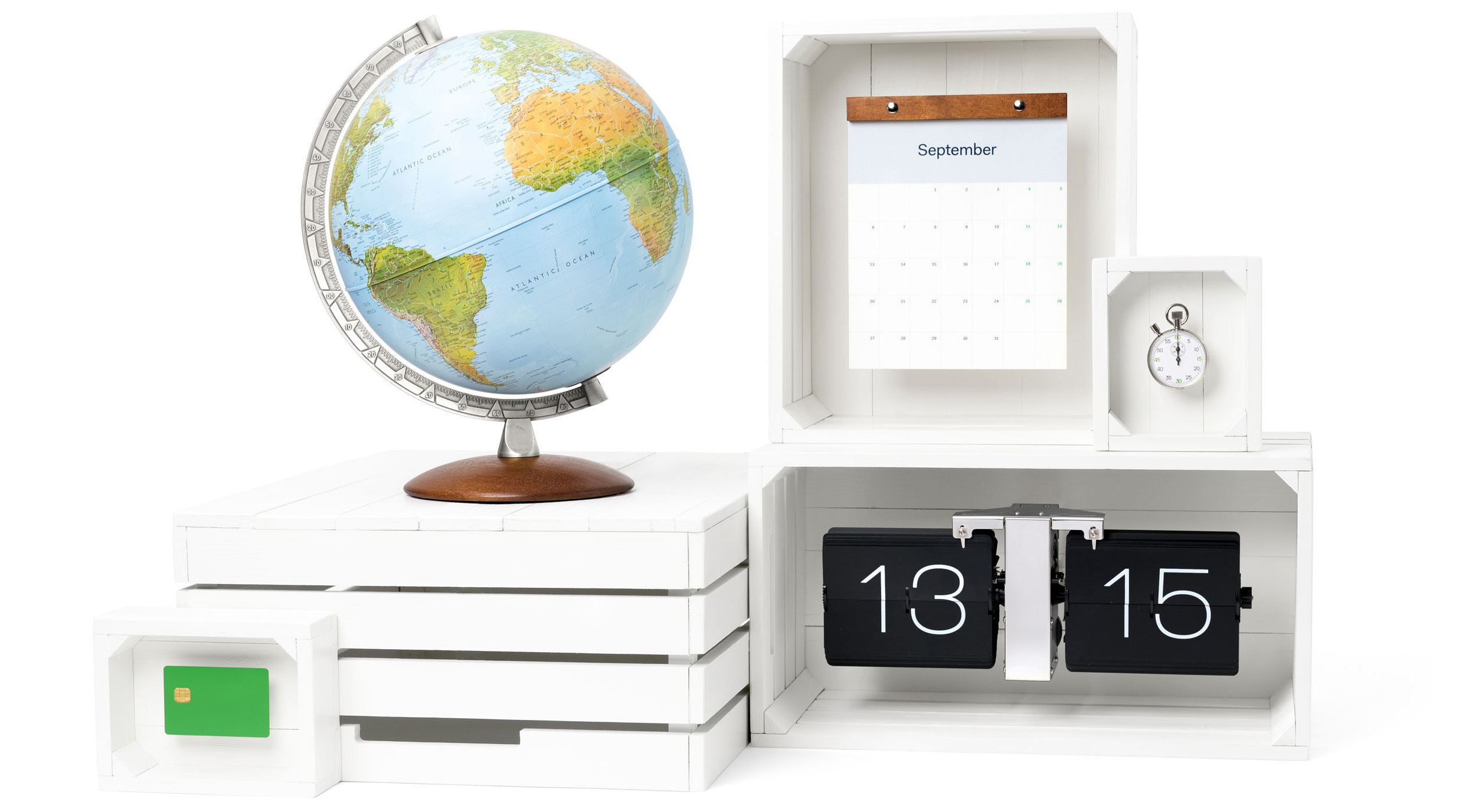 A variety of items displayed on white boxes and a white background