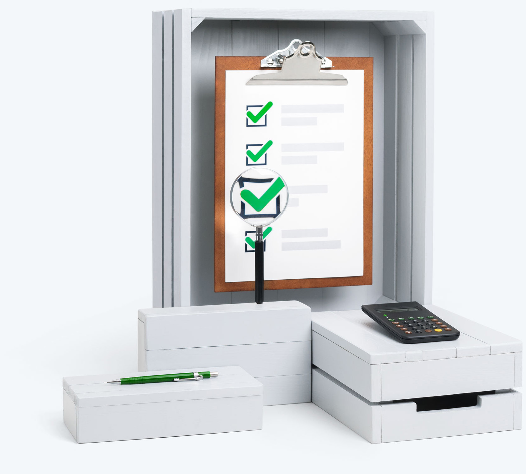 A clipboard standing on white boxes displaying magnifying glass and green ticks
